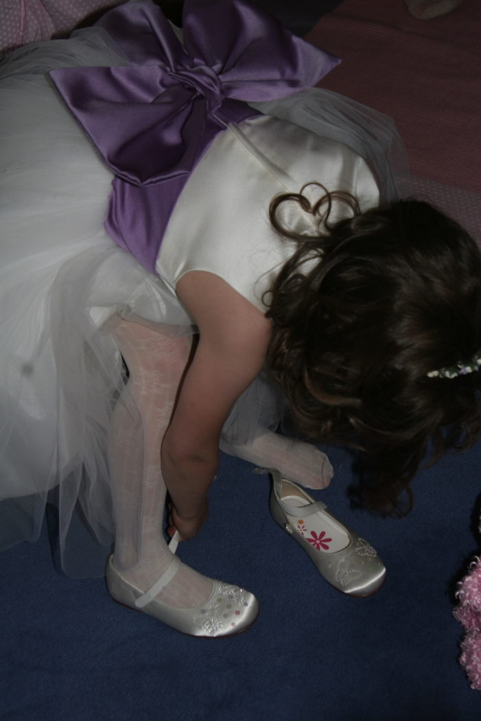 Rosa putting her shoes on