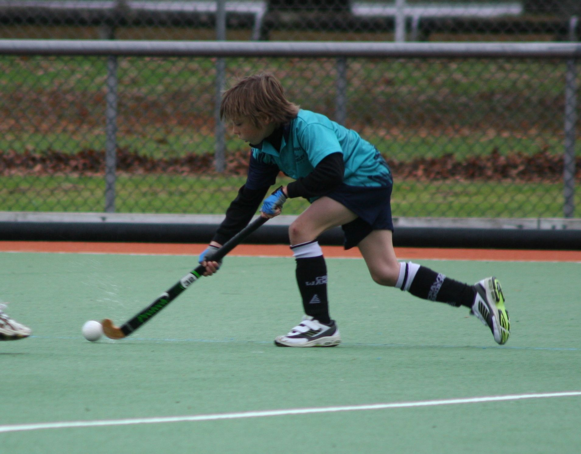 Aonghas playing hockey