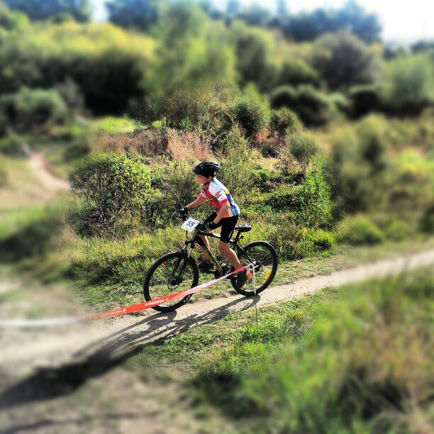 Boy riding bike in mountain bike race