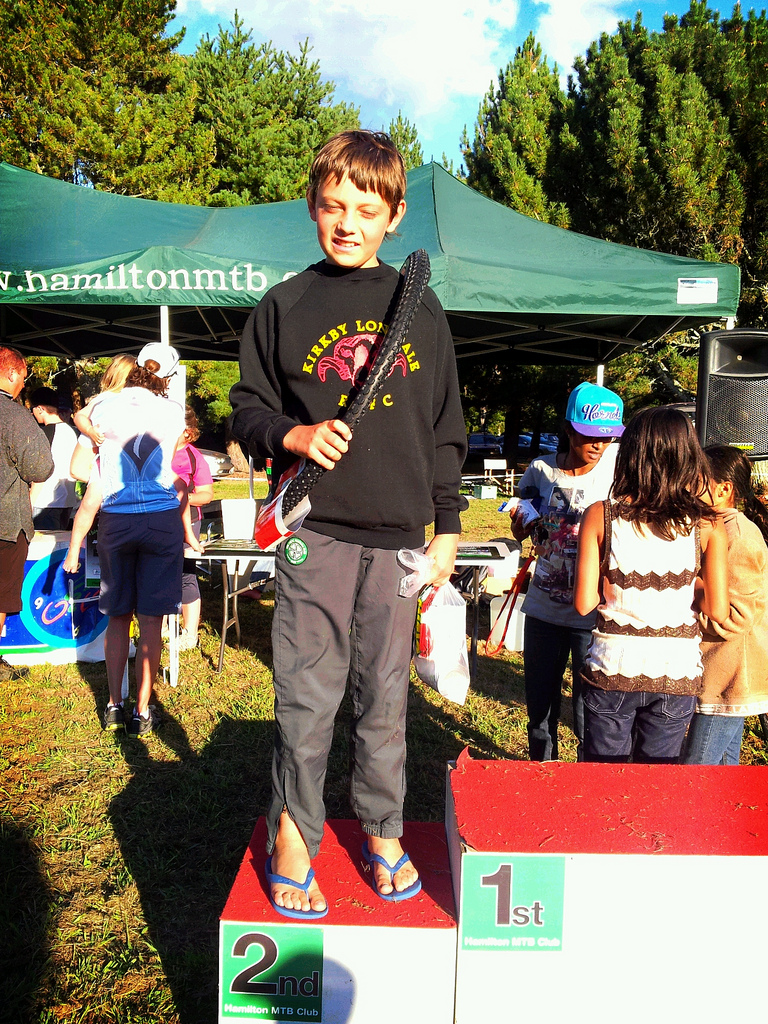 Boy on the winners podium after coming 2nd in mountain bike race